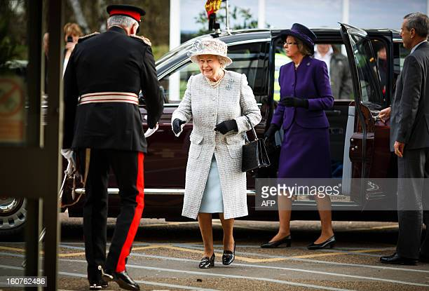 Britain's Queen Elizabeth II arrives to visit to the Queen Elizabeth Hospital in King's Lynn Norfolk east England on February 5 where she opened the...