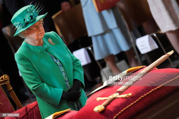 TOPSHOT Britain's Queen Elizabeth II attends a service to mark the Centenary of the Order of the British Empire at St Paul's Cathedral London May 24...