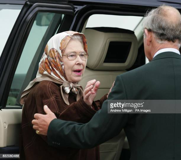 Britain's Queen Elizabeth II bids farewell to her son the Prince of Wales as they leave The Hebridean Princess boat at the end of her weeklong...
