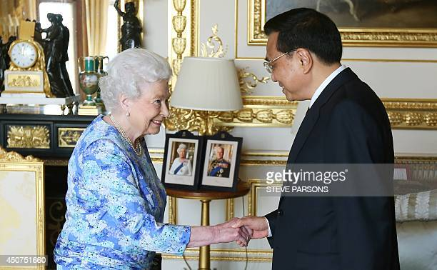 Britain's Queen Elizabeth II Chinese Premier Li Keqiang at Windsor Castle in Windsor west of London on June 17 2014 on the first full day of a three...