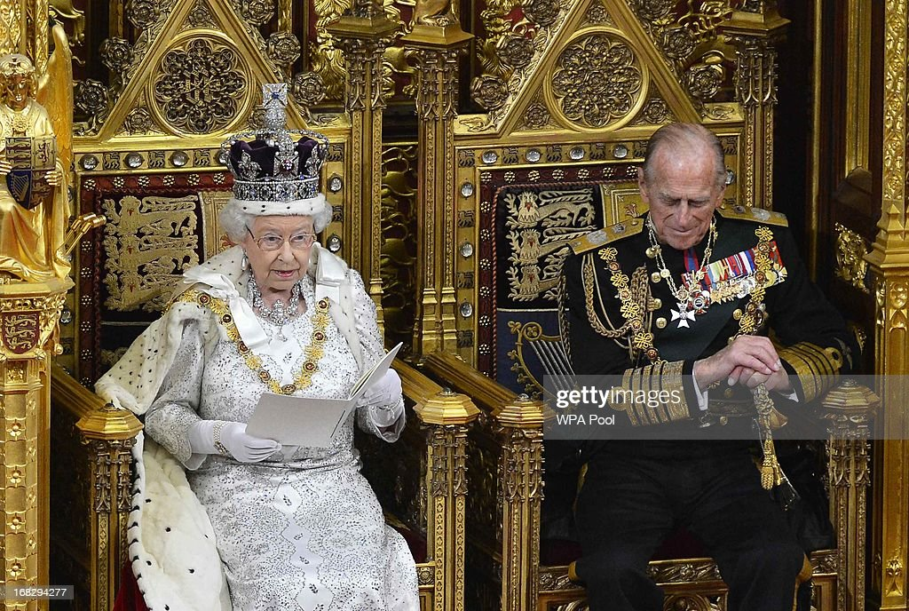 Britain's Queen <a gi-track='captionPersonalityLinkClicked' href=/galleries/search?phrase=Elizabeth+II&family=editorial&specificpeople=67226 ng-click='$event.stopPropagation()'>Elizabeth II</a> delivers her speech next to Prince Phillip, Duke of Edinburgh (R) at the State Opening of Parliament on May 8, 2013 in London, England. Queen <a gi-track='captionPersonalityLinkClicked' href=/galleries/search?phrase=Elizabeth+II&family=editorial&specificpeople=67226 ng-click='$event.stopPropagation()'>Elizabeth II</a> unveiled the coalition government's legislative programme in a speech delivered to Members of Parliament and Peers in The House of Lords. Proposed legislation is expected to be introduced on toughening immigration regulations, capping social care costs in England and setting a single state pension rate of 144 GBP per week.