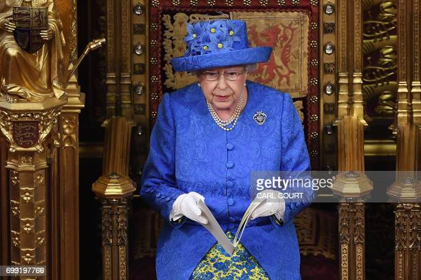 Britain's Queen Elizabeth II delivers the Queen's Speech during the State Opening of Parliament in the Houses of Parliament in London on June 21 2017...