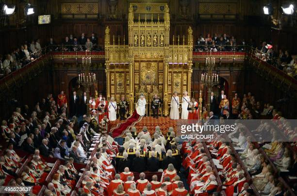 Britain's Queen Elizabeth II delivers the Queen's Speech from the Throne in the House of Lords flanked by Prince Philip Duke of Edinburgh and...