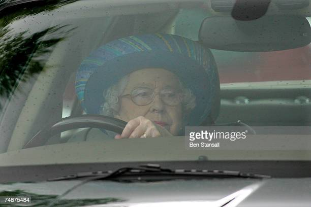 Britain's Queen Elizabeth II drives her Jaguar car to The Credit Suisse Royal Windsor Cup Final at Guards Polo Club on June 24 2007 in Windsor England