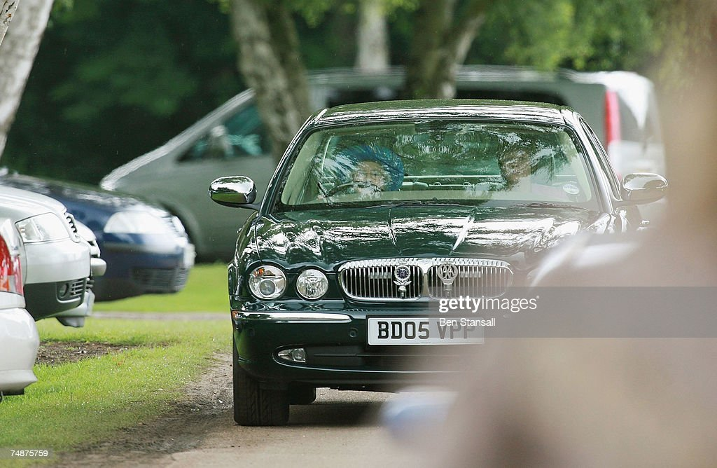 Britains Queen Elizabeth II drives her Jaguar car to The Credit Suisse Royal Windsor Cup Final at Guards Polo Club on June 24 2007 in Windsor England