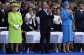 Britain's Queen Elizabeth II French President Francois Hollande and Queen Margrethe of Denmark clap during the international DDay commemoration...