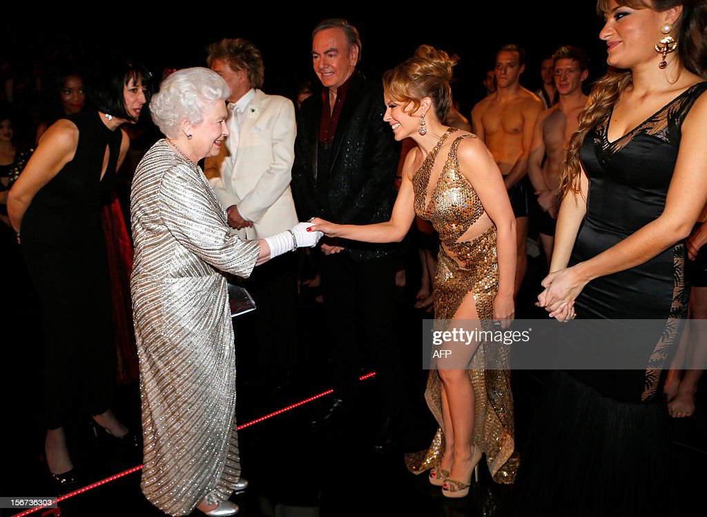Britain's Queen Elizabeth II (L) greets Australian singer Kylie Minogue (R) after the Royal Variety Performance at the Royal Albert Hall in London on November 19, 2012. The Queen, accompanied by The Duke of Edinburgh, attended the Royal Variety Performance in the show's 100th anniversary year where she met with stars of the show including Kylie Minogue, tenor Andrea Bocelli and the performing dog Pudsey.