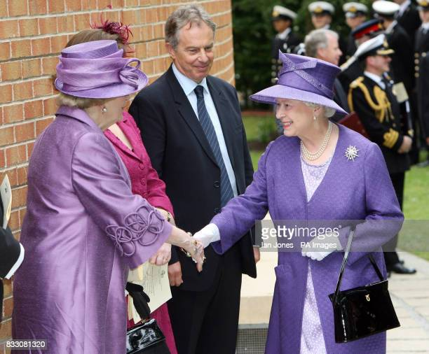 Britain's Queen Elizabeth II greets Baroness Thatcher while Prime Minister Tony Blair looks on outside the Falkland Islands Memorial Chapel at...