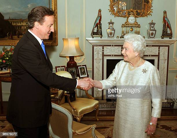 Britain's Queen Elizabeth II greets David Cameron at Buckingham Palace in an audience to invite him to be the next Prime Minister on May 11 2010 in...