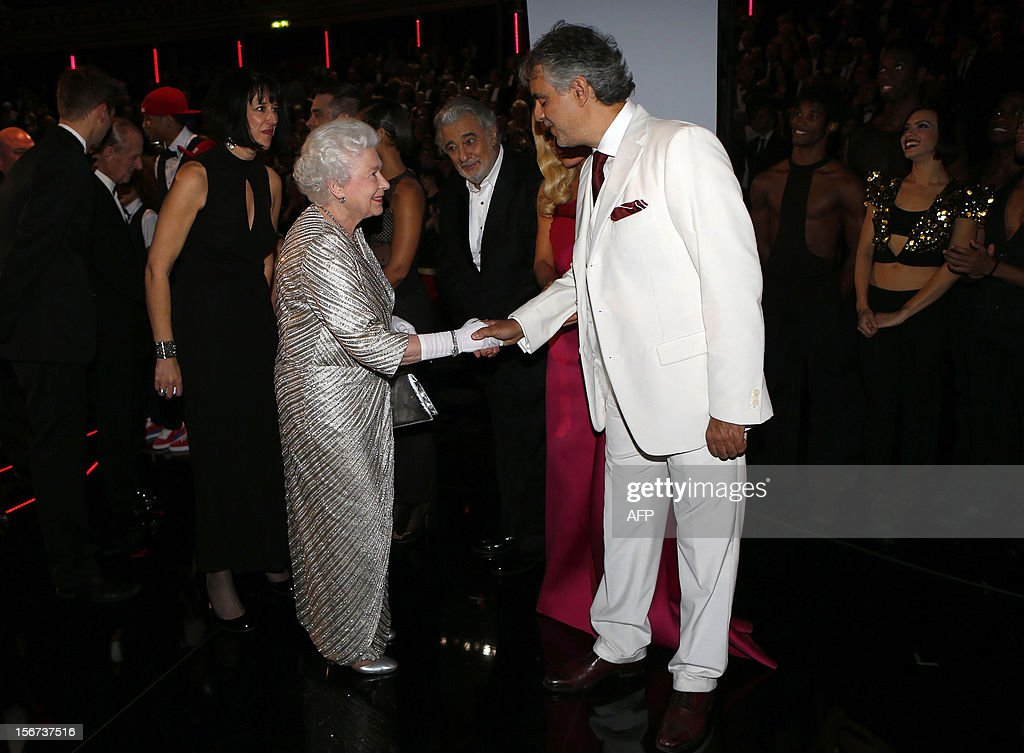 Britain's Queen Elizabeth II (L) greets Italian tenor Andrea Bocelli (R) after the Royal Variety Performance at the Royal Albert Hall in London on November 19, 2012. The Queen, accompanied by The Duke of Edinburgh, attended the Royal Variety Performance in the show's 100th anniversary year where she met with stars of the show including Kylie Minogue, tenor Andrea Bocelli and the performing dog Pudsey.
