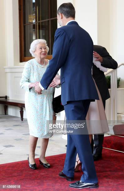 Britain's Queen Elizabeth II greets Spanish King Felipe VI at Buckingham Palace in central London on July 14 the third and final day of the Spanish...
