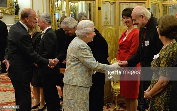 Britain's Queen Elizabeth II greets The Bishop of London Richard Chartres during a reception for The Queen Elizabeth Diamond Jubilee Trust at...