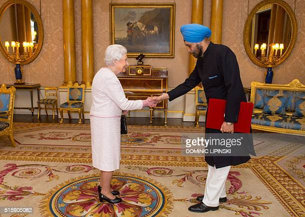 Britain's Queen Elizabeth II greets the High Commissioner for India Navtej Sarna at an audience at Buckingham Palace in London on March 16 2016 / AFP...