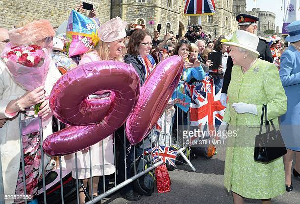 TOPSHOT Britain's Queen Elizabeth II greets wellwishers during a 'walkabout' on her 90th birthday in Windsor west of London on April 21 2016 Britain...