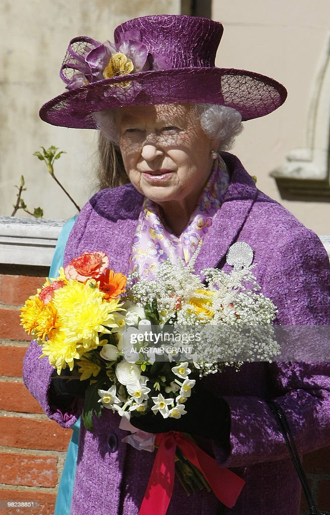 Britain's Queen Elizabeth II holds flowers as she leaves an Easter Sunday church service in Windsor on April 4, 2019.