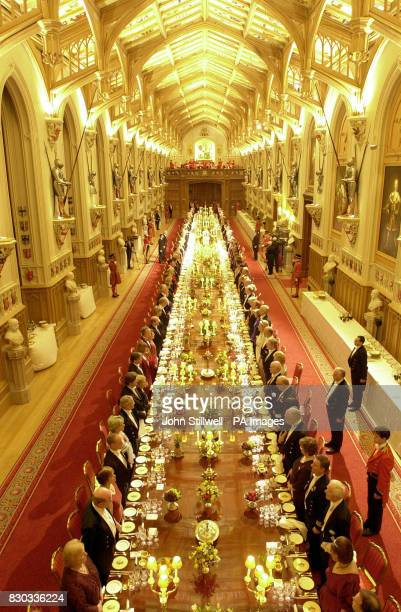 Britain's Queen Elizabeth II host's a state banquet in St George's Hall in Windsor Castle for Queen Margrethe and Prince Henrik of Denmark The Danish...