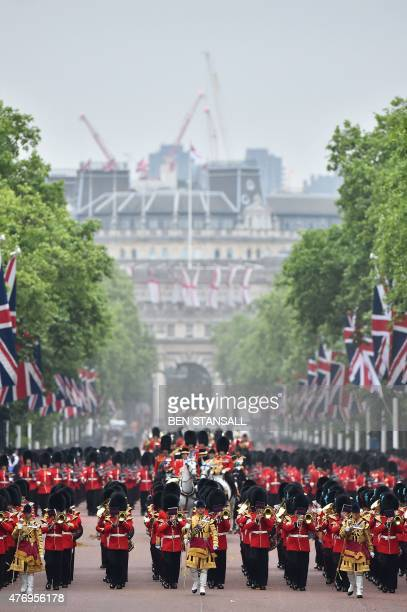 Britain's Queen Elizabeth II in a horsedrawn carriage proceeds along the Mall returning to Buckingham Palace from Horse Guards Parade preceeded and...