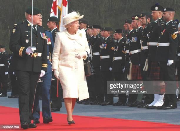 Britain's Queen Elizabeth II inspects a Canadian honour guard during a ceremony at the Vimy memorial near Lille in northern France