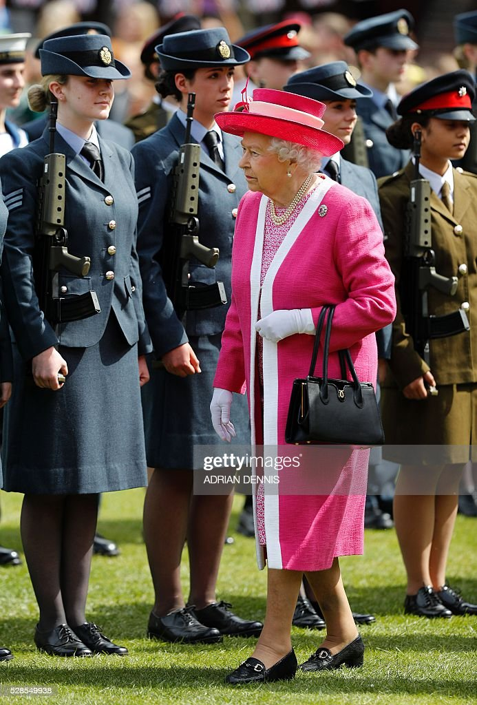 Britain's Queen Elizabeth II inspects a Guard of Honour as she arrives to visit Berkhamsted School, north-west of London on May 6, 2016, on the 475th Anniversary of its foundation. The Queen, in her role as Patron of the school, will inspect a Guard of Honour formed from the school's Combined Cadet Force, and view displays celebrating various aspects of school life. Berkhamsted School was founded in 1541 by John Incent, Dean of St Paul's, initially as a school of just 144 pupils. Berkhamsted Schools Group is currently responsible for the education of over 1,800 pupils. / AFP / ADRIAN