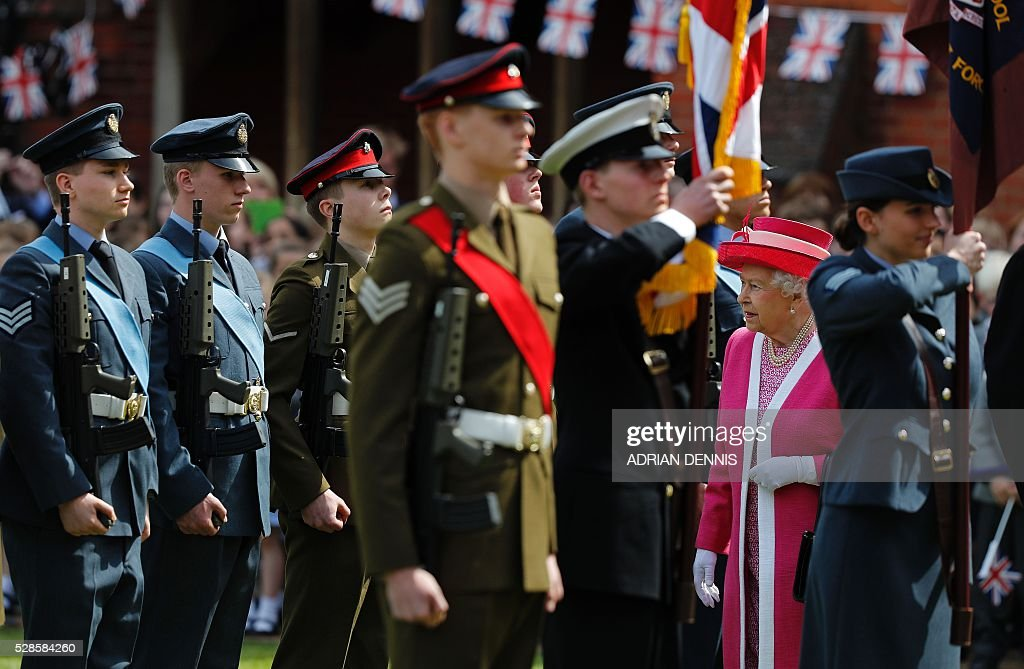 Britain's Queen Elizabeth II inspects a Guard of Honour during her visit to Berkhamsted School, north-west of London on May 6, 2016, on the 475th Anniversary of its foundation. The Queen, in her role as Patron of the school, will inspect a Guard of Honour formed from the school's Combined Cadet Force, and view displays celebrating various aspects of school life. Berkhamsted School was founded in 1541 by John Incent, Dean of St Paul's, initially as a school of just 144 pupils. Berkhamsted Schools Group is currently responsible for the education of over 1,800 pupils. / AFP / ADRIAN