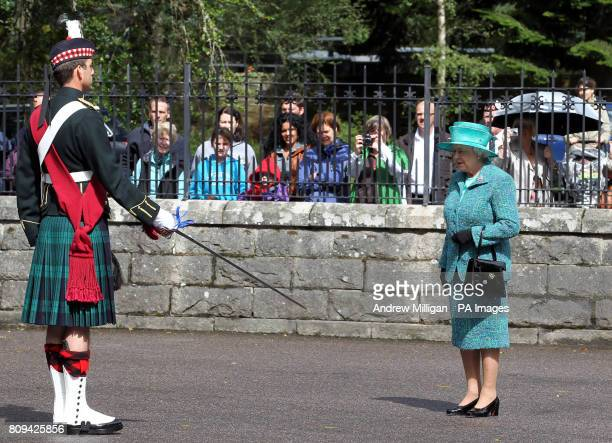 Britain's Queen Elizabeth II inspects the Ballater Guard made up of soldiers from the Argyll and Sutherland Highlanders 5th Battalion The Royal...