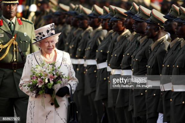 Britain's Queen Elizabeth II inspects the guard of honour on her arrival at the State House Entebbe Uganda for the start of a four day visit to the...