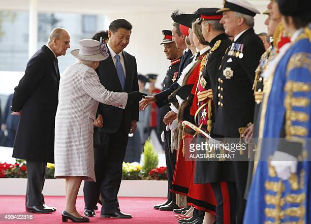 Britain's Queen Elizabeth II introduces China's President Xi Jinping to British officials and dignitaries flanked by Britain's Prince Philip Duke of...