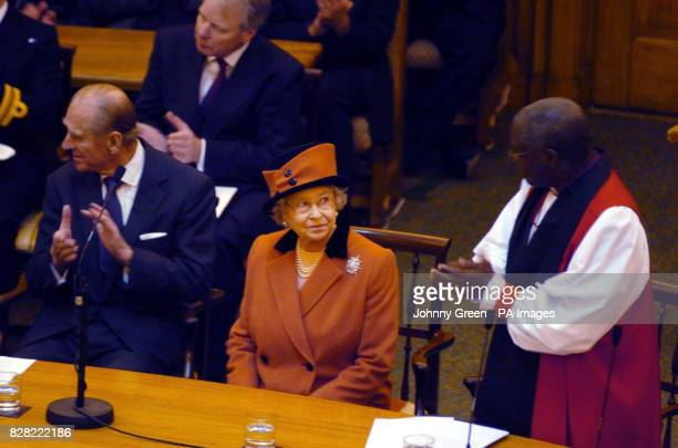 Britain's Queen Elizabeth II is applauded by the Bishop of York after having delivered a speech at the Inauguration of the Eighth General Synod of...