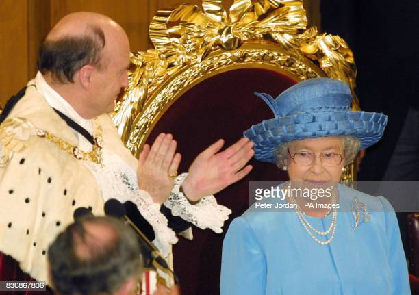 Britain's Queen Elizabeth II is applauded by the Lord Mayor of London after her speach during the banquet at the Guild hall held in her honour to...