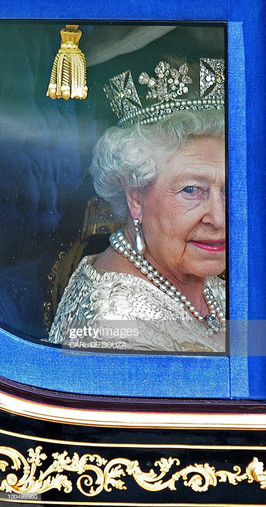 Britain's Queen Elizabeth II, is driven in a horse drawn carriage, to the Houses of Parliament, for the State Opening of Parliament, in central London on May 25, 2010. Britain's Queen Elizabeth II set out the new coalition government's legislative programme on Tuesday in a ceremony of pomp and history following the closest general election for decades.