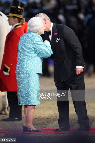 Britain's Queen Elizabeth II is greeted by Britain's Prince Charles Prince of Wales as she arrives to attend the final night of The Queen's 90th...
