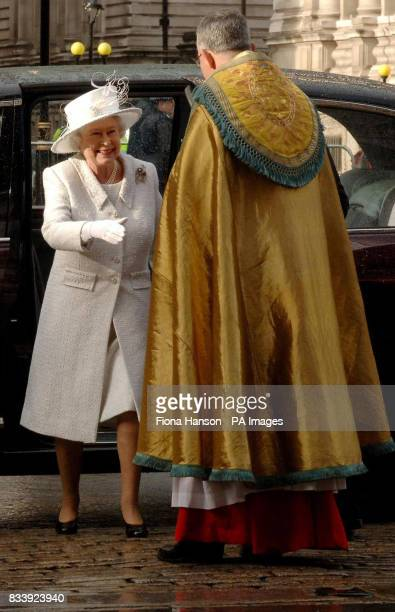 Britain's Queen Elizabeth II is greeted by Dean of Westminster Abbey Rev John Hall as she arrives at Westminster Abbey London for a service of...