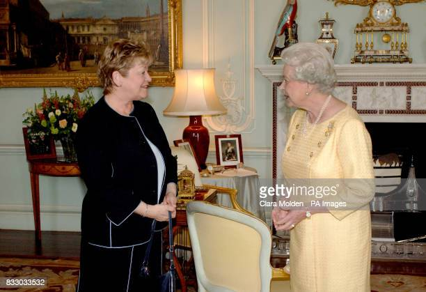 Britain's Queen Elizabeth II is greeted by the Lieutenant Governor of Prince Edward Island Mrs Barbara Hagerman inside Buckingham Palace London