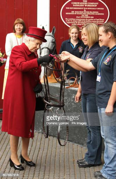 Britain's Queen Elizabeth II is presented with a set of reins during a visit to Capel Manor College in Enfield Middlesex where she opened the Queen...