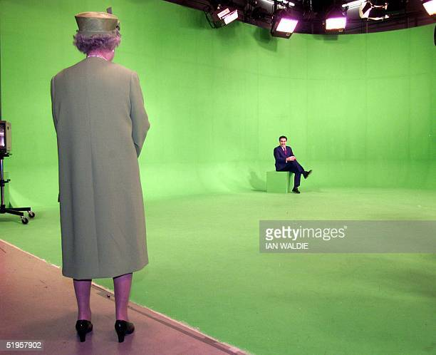 Britain's Queen Elizabeth II is seen before a greenscreen background where newsreader Dermot Murnaghan is seated as she visits the news studios of...