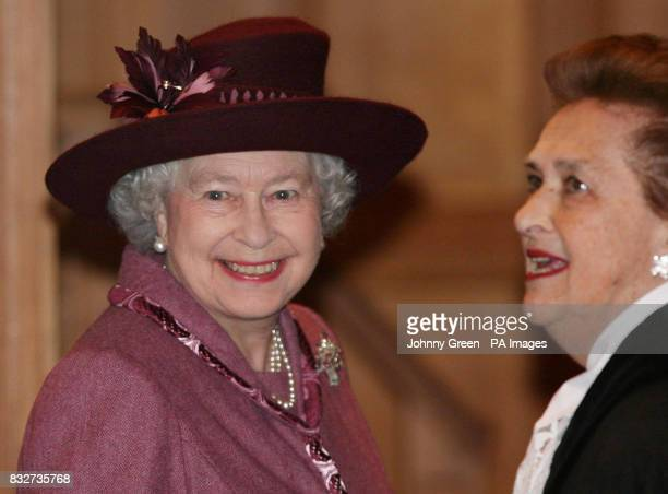 Britain's Queen Elizabeth II is shown around the International Court of Justice by the President of the ICJ Dame Rosalynd Higgins as she visits the...