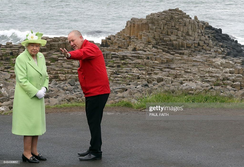 Britain's Queen Elizabeth II (L) is shown Giant's causeway, a world heritage site by Neville McConachie, a National Trust ranger near Bushmills in Northern Ireland during a two-day visit. FAITH