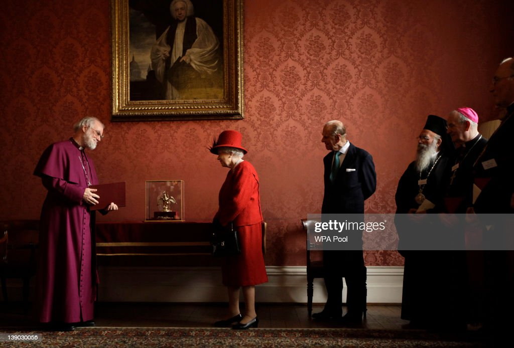 Britain's Queen Elizabeth II is shown the Ampulla and Coronation Spoon, which was used at her Coronation in 1953, by the Archbishop of Canterbury <a gi-track='captionPersonalityLinkClicked' href=/galleries/search?phrase=Rowan+Williams&family=editorial&specificpeople=239468 ng-click='$event.stopPropagation()'>Rowan Williams</a> as her husband Prince Philip, Duke of Edinburgh , and other Christian guests watch, during a multi-faith reception at Lambeth Palace on February 15, 2012 in London, England. The event features leaders from the Christian, the Baha'i, the Buddhist, Hindu, Jain, Jewish, Muslim, Sikh, and Zoroastrian communities.