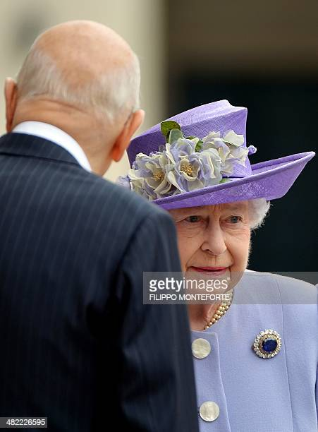 Britain's Queen Elizabeth II is welcomed by Italian President Giorgio Napolitano at the Quirinale Palace in Rome on April 3 2014 Britain's Queen...