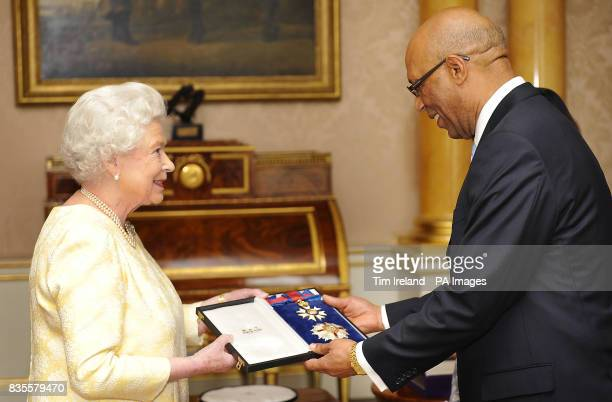 Britain's Queen Elizabeth II knights GovernorGeneral of Jamaica Sir Patrick Allen where he was presented his credentials during a private audience in...