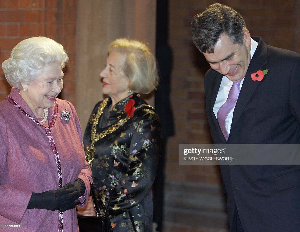 Britain's Queen <a gi-track='captionPersonalityLinkClicked' href=/galleries/search?phrase=Elizabeth+II&family=editorial&specificpeople=67226 ng-click='$event.stopPropagation()'>Elizabeth II</a> (L) laughs with Prime Minister Gordon Brown as she arrives to officially open the new St. Pancras International Station in London, 06 November 2007. Queen <a gi-track='captionPersonalityLinkClicked' href=/galleries/search?phrase=Elizabeth+II&family=editorial&specificpeople=67226 ng-click='$event.stopPropagation()'>Elizabeth II</a> launched a luxurious new international rail terminal in London 06 November, marking the beginning of a new era of high-speed train travel linking Britain to continental Europe. AFP PHOTO / Kirsty Wigglesworth / POOL