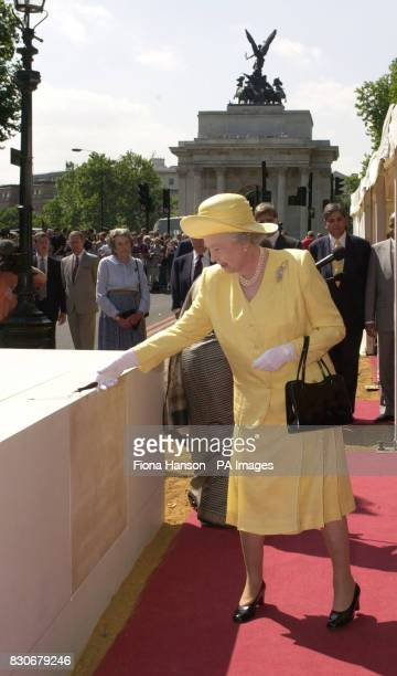 Britain's Queen Elizabeth II lays the foundation stone of the Memorial Gates a monument to Indian African and Caribbean World War volunteers on...