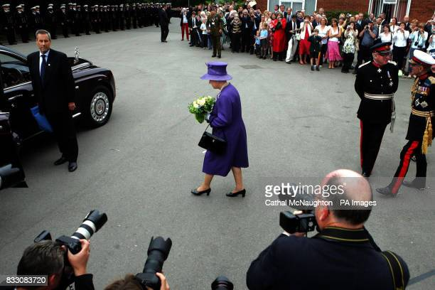Britain's Queen Elizabeth II leaves a church service to mark the 25th anniversary of the Falkland Islands' liberation at the Falkland Islands...