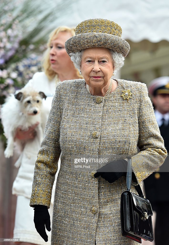Britain's Queen Elizabeth II leaves after offically opening the Mary Tealby dog kennels at Battersea Dogs and Cats Home in London on March 17, 2015.