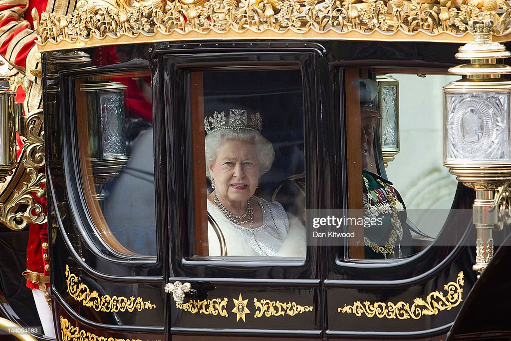 Britain's Queen Elizabeth II leaves Buckingham Palace to address Parliament at the official State Opening of Parliament ceremony on May 9 2012 in...