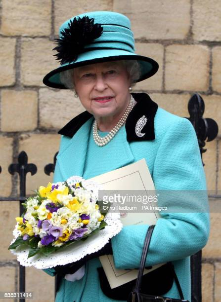Britain's Queen Elizabeth II leaves Bury St Edmunds Cathedral after attending the traditional Maundy Thursday Service at Bury St Edmunds Suffolk