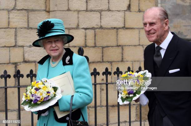 Britain's Queen Elizabeth II leaves Bury St Edmunds Cathedral with HRH The Duke of Edinburgh after attending the traditional Maundy Thursday Service...