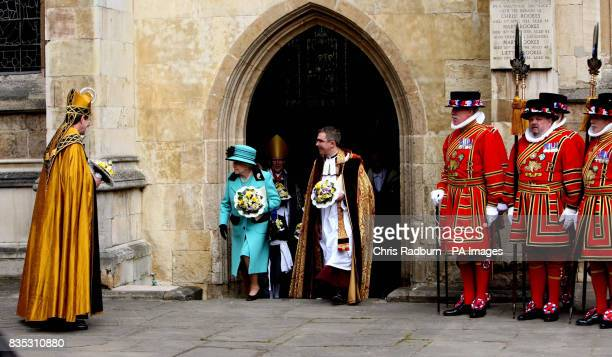 Britain's Queen Elizabeth II leaves Bury St Edmunds Cathedral with clergy after attending the traditional Maundy Thursday Service at Bury St Edmunds...