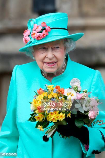 Britain's Queen Elizabeth II leaves the Easter Sunday service at St George's Chapel Windsor Castle west of London on April 16 2017 / AFP PHOTO / POOL...