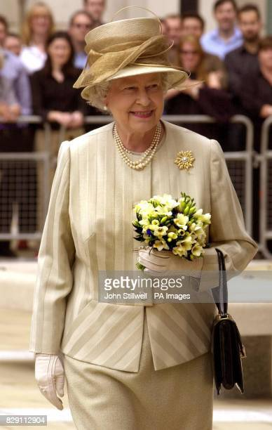 Britain's Queen Elizabeth II leaves the new Stock Exchange building in Paternoster Square in the City of London after officially opening it this...